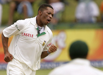 South Africa's Makhaya Ntini celebrates after taking the wicket of Pakistan's Imran Farhat on the fourth day of the second test cricket match