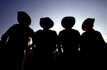 Cowboys are silhouetted during the Barretos Rodeo International Festival in Barretos