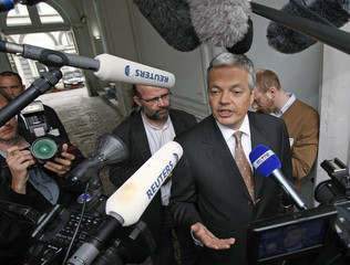 MR party President Reynders speaks to reporters outside the Belgian Parliament in Brussel