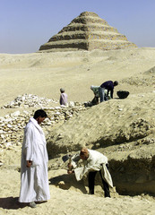 EGYPTIAN ANTIQUITIES WORKERS UNEARTH A NEWLY DISCOVERED TOMB IN EGYPT.