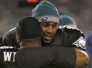 Eagles quarterback McNabb hugs teammate Westbrook while playing against the Cardinals in Philadelphia