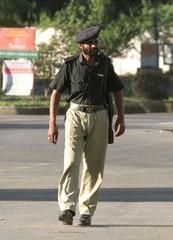 A PAKISTANI POLICEMAN GUARDS A KARACHI STREET IN KARACHI.