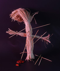 Image of a voodoo doll in a dark background