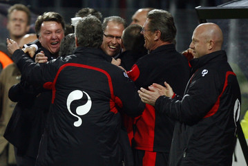 AZ Alkmaar's coach Louis van Gaal and his staff react after winning their UEFA Cup second knockout round, second leg soccer match against Newcastle in Alkmaar