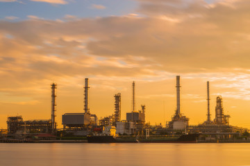 Oil refinery or petroleum refinery industrial process plant with sunrise, oil refineries use much of the technology, as types of chemical plants, the downstream side of the petroleum industry.