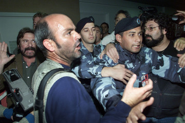 SOLDIERS AND MEMBERS OF SECURITY TEAM OF CUBAN AMBASSADOR ALVAREZSTRUGGLE WITH THE MEDIA AT ...