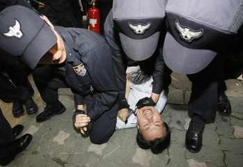 Police officers arrest an anti-North Korea protester during a rally in front of a venue for the 21st inter-Korean ministerial talks in Seoul