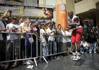 Boxer Floyd Mayweather works out on Hollywood Boulevard in Hollywood