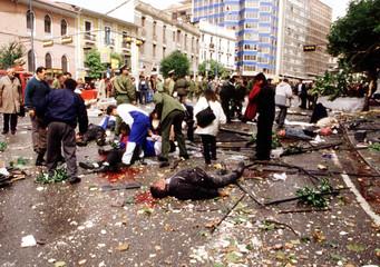 BLAST VICTIMS LIE AMID RUBBLES IN STREET OF LA PAZ.