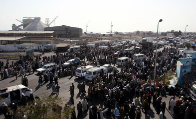 Hundreds of family members and friends stand outside the Red Sea port of Safaga