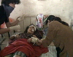 A victim from a bomb blast is treated in a hospital in Dimapur.