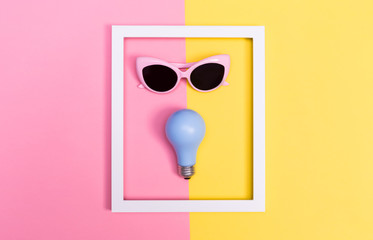 Bright light theme with lightbulb and sunglasses