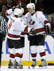 CANADIANS CELEBRATE AFTER GOAL IN MENS OLYMPIC ICE HOCKEY.
