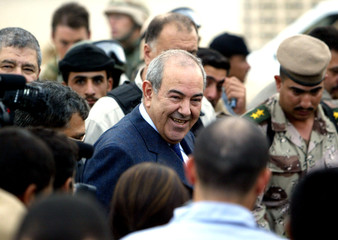 Iraqi Prime Minister Iyad Allawi smiles as he meets Iraqi troops during a brief visit to the main U.S. ...