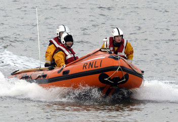RNLI RESCUE WORKERS RETURN TO BASE AT MORECAMBE BAY.