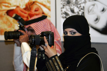 Saudi photographer Muneera Al Romaih poses during the opening of a gallery in Amman