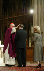 A worshiper receives ashes from Cardinal Egan during an Ash Wednesday service in St. Patrick's ...