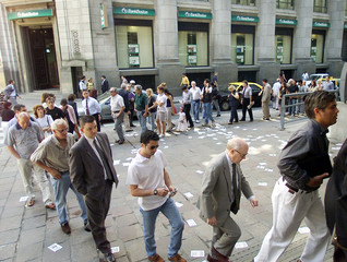 BUENOS AIRES RESIDENTS LINE UP TO ENTER BANK.