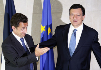 Nicolas Sarkozy, France's newly-elected President, poses with European Commission President Jose Barroso in Brussels