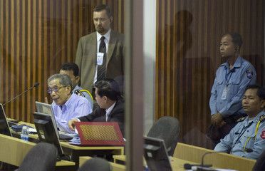 Kaing Guek Eav sits in court moments before the start of his trial on the outskirts of Phnom Penh