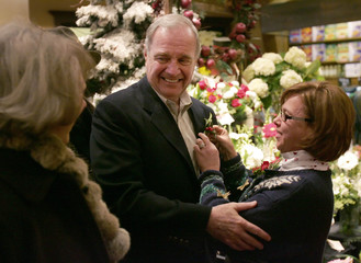 Paul Martin looks at his wife Sheila while receiving a festive corsage in Windsor