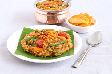 South Indian traditional and popular vegetarian rice dish, bisi bele bath, which has rice, vegetables and pigeon pea as the main ingredients.