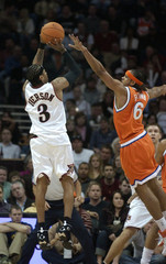 76ers Iverson shoots over Cleveland Cavaliers Brown