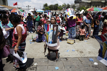 A supporter of Guatemala's president Alvaro Colom takes part in a counter demonstration in front of the National Palace in Guatemala City