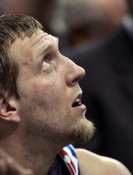 Mavericks' Nowitzki looks up at the scoreboard during a time out against the Warriors during first half action in Game 1 of their Western Conference NBA men's basketball playoff series in Dallas