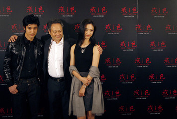 """Actor Wang, director Lee and actress Tang pose for the media before a news conference for """"Lust, Caution"""" in Taipei"""