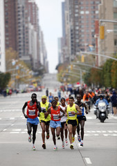 Runners in the lead pack run up 1st Avenue, including Meb Keflezighi who went on to win the 2009 New York City Marathon