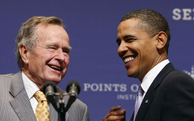 U.S. President Barack Obama is introduced to speak by former President George H.W. Bush at the Points of Light forum at Texas A&M University in College Station, Texas