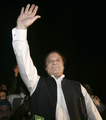 Pakistan's former prime minister Nawaz Sharif waves to supporters during a rally in Gujranwala near Lahore