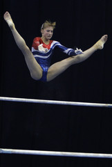 Russia's Kurbatova competes on uneven bars during apparatus finals at the World cup in Artistic Gymnastics in Moscow