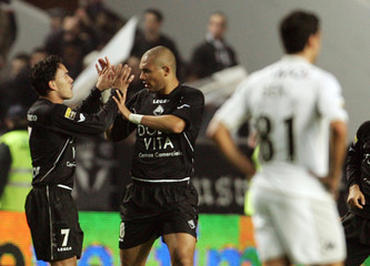 Academicas Marcel is congratulated by team mate Luciano during match against Guimaraes in Coimbra