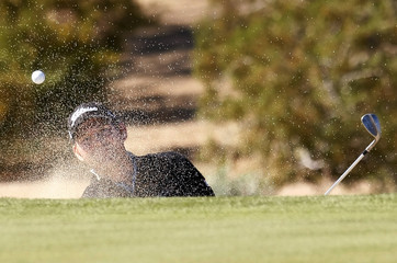 Troy Matteson hits out of the bunker on the 11th hole during the third round of the FBR Open golf tournament in Scottsdale, Arizona