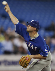Rangers pitcher Millwood throws to Blue Jays during the first inning of their American League MLB baseball game in Toronto