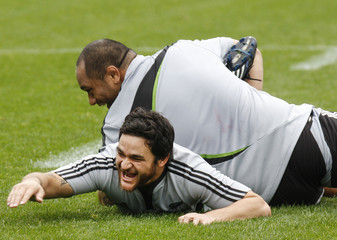 All Blacks' Weepu and Tialata wrestle during the captain's run at Eden Park in Auckland