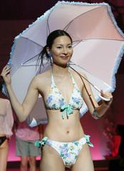 MODEL PRESENTS FLOWER PATTERN SWIMSUIT OF TORAY IN TOKYO.