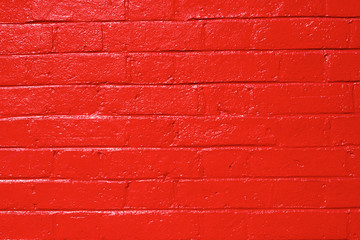 red painted shiny brick wall texture