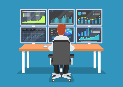Businessman or stock market trader working at desk.