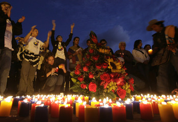 Demonstrators light candles during a 90-hour-long event at Bolivar square in Bogota
