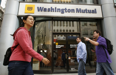 Pedestrians walk past a Washington Mutual bank branch in New York City