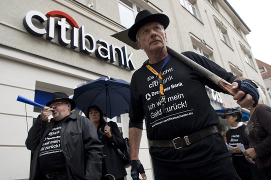 Small investors who lost money due to the collapse of the Lehman Brothers investment bank protest in front of a Citibank branch in Berlin