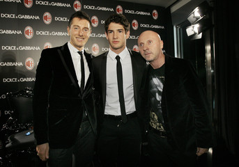 Ac Milan's player Pato pose for photographers with designers Dolce and Gabbana  in Milan