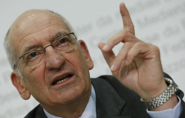 Swiss Interior Minister Couchepin gestures during a news conference after the weekly meeting of the Federal Council in Bern
