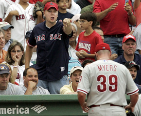 Fans gesture towards Philadelphia Phillies' pitcher Myers at end of fourth inning against Boston Red Sox in Boston