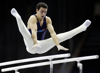 France's Yann Cucherat competes on the parallel bars during the Artistic Gymnastics World Cup Final ..
