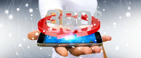 Man holding 360 degree 3D render icon over mobile phone