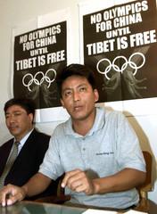 Karma Yeshi (R), President of the Tibetan Youth Congress, makes a point as Ngawang Gelek, Chairman o..